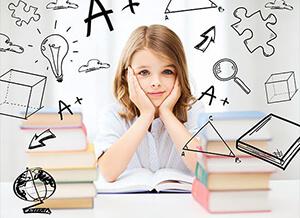 ילדה יושבת בכיתה עם ציורים בכל מיני נושאים לאבחון קשב וריכוז